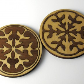 Wooden coasters with laser cut inlay