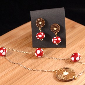 Earrings and necklace with red and white glass beads and laser engraved wood mushroom spore prints