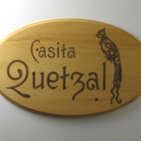 Casita Quetzal wooden sign with dark inlay of words and stylized bird