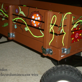 Painted wagon with illuminated vines